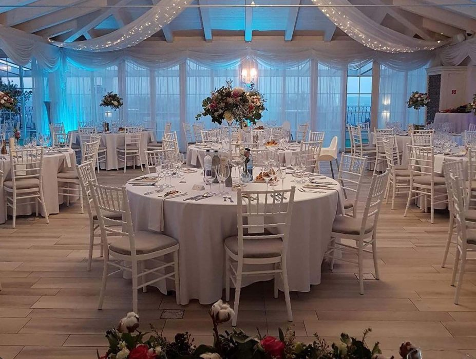 RGB illumination of the wedding hall, crystal chandelier, LED illumination of the restaurant