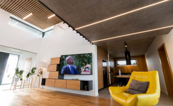LED lines in the living room, wooden slats on the ceiling, LED strip in the living room
